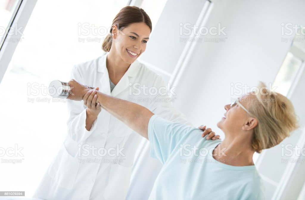 Shoulder pain therapy. stock photo