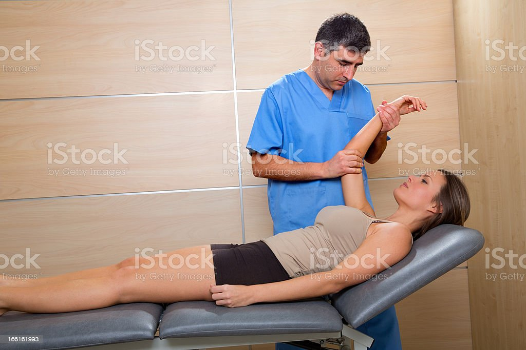 Shoulder physiotherapy doctor therapist and woman patient stock photo