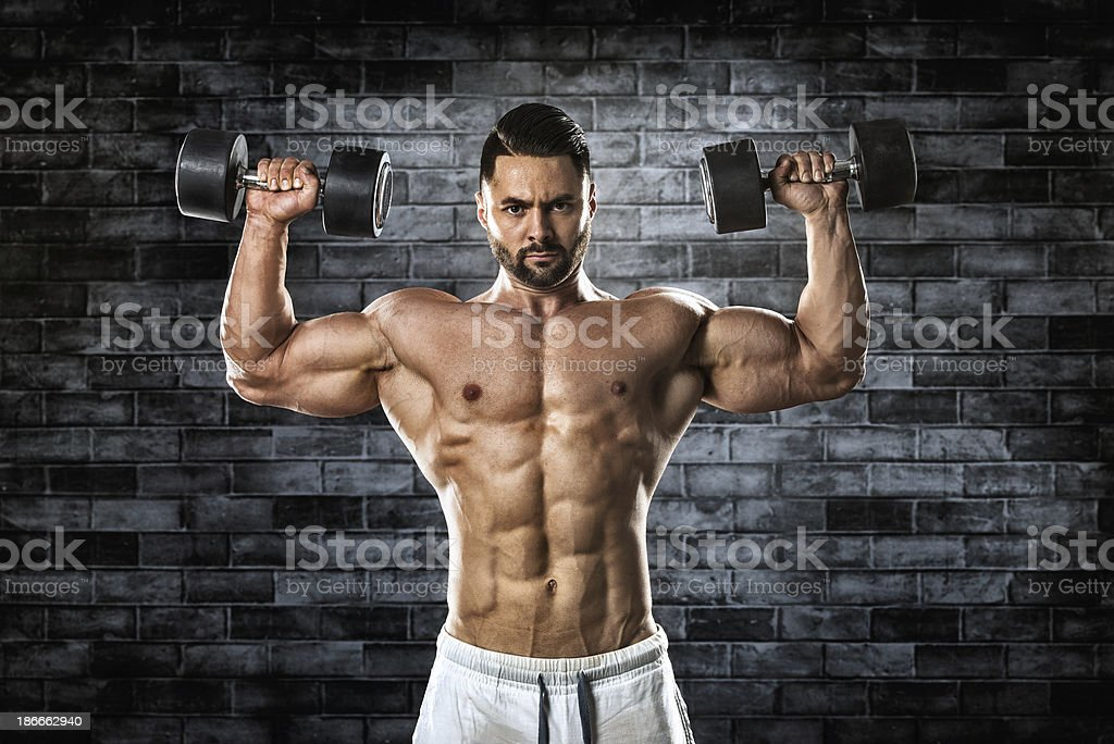 Shoulder press with dumbbells royalty-free stock photo