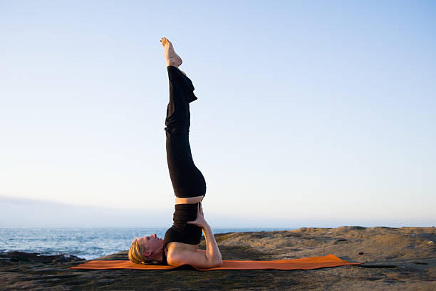 Shoulder Stand  shoulder stand stock pictures, royalty-free photos & images