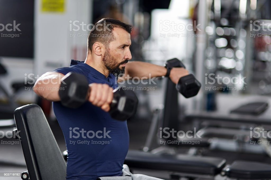 Shoulder workout with dumbbells stock photo