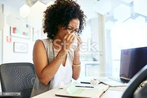 Shot of a businesswoman working at her desk