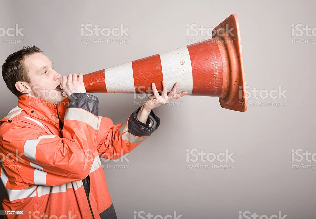 Shout through a traffic cone royalty-free stock photo