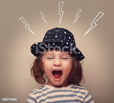 istock Shouting angry small kid with open mouth and lightnings above 536279405