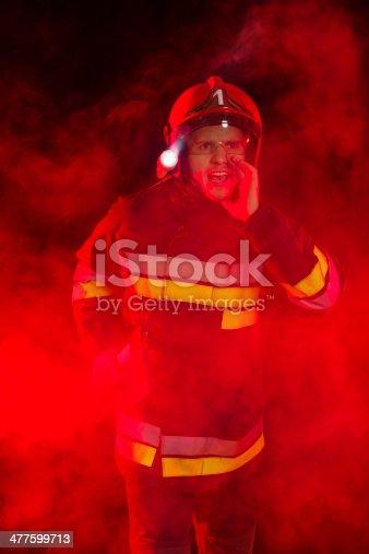 istock Shouting fireman in smoke. 477599713