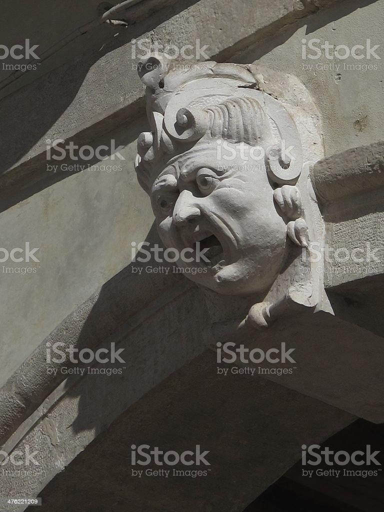 Shouting man, detail of a Renaissance facade royalty-free stock photo