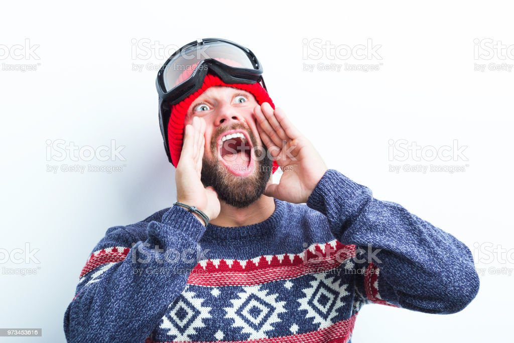 Shouting man in warm clothing Close up of young beard man shouting on white background, Caucasian man in winter outfit. Adult Stock Photo