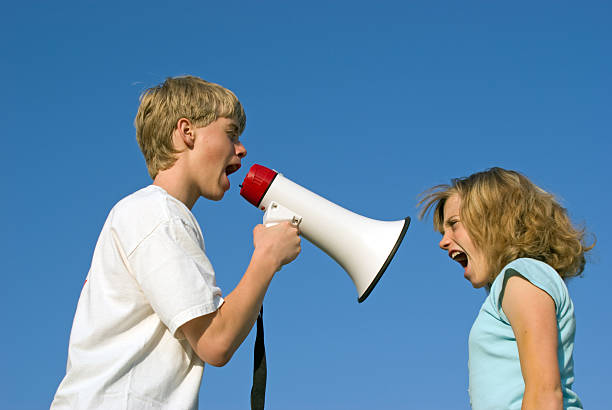Shouting Match A teenage boy and adolescent girl shouting at each other.Similar Images. adversarial stock pictures, royalty-free photos & images