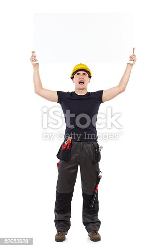 istock Shouting mechanic holding placard 526536281