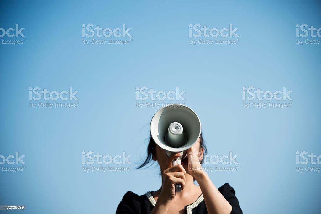 shouting through megaphone stock photo