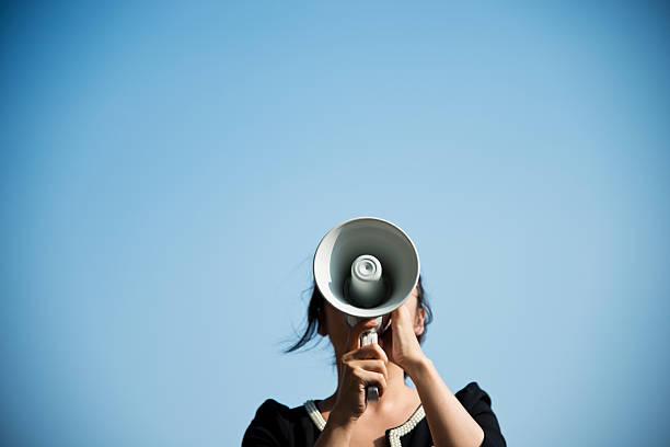 shouting through megaphone - megafon stok fotoğraflar ve resimler