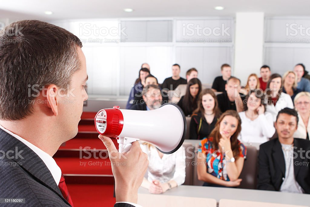 Shouting with a megaphone to the audience stock photo