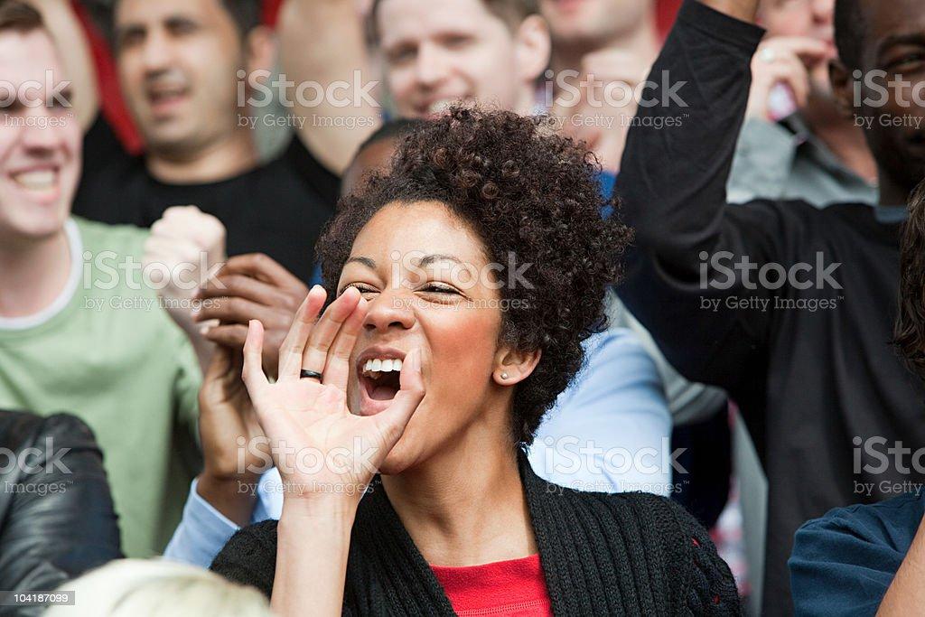Shouting woman at football match stock photo