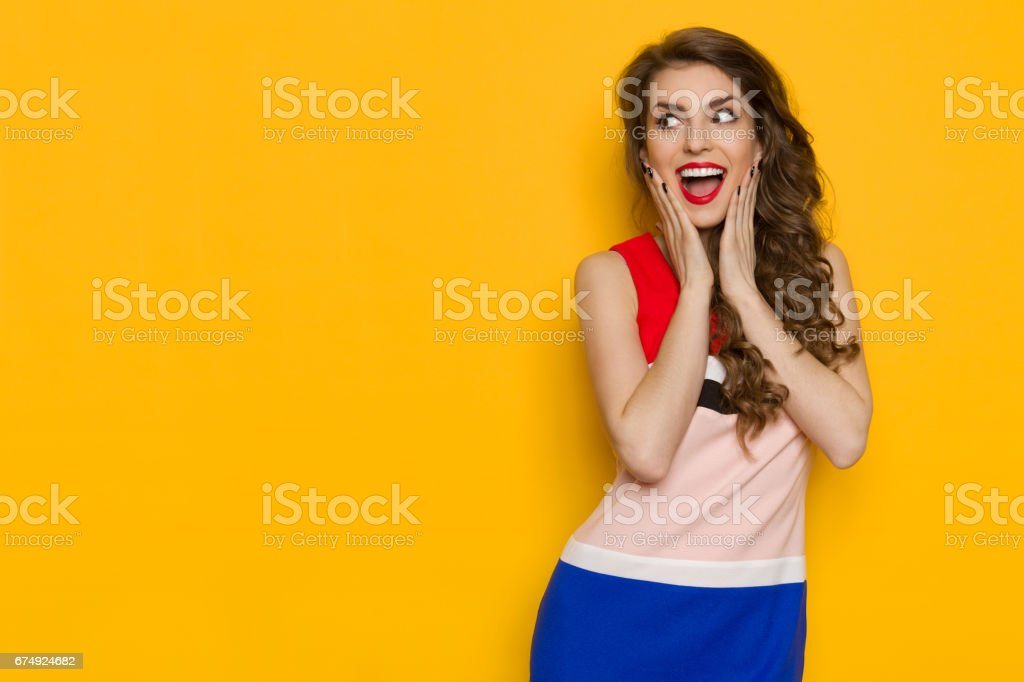 Shouting Young Woman Is Holding Head In Hands And Looking Away royalty-free stock photo