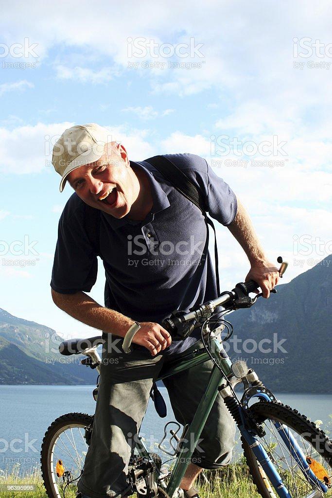 Shoutinng man on the bike stock photo
