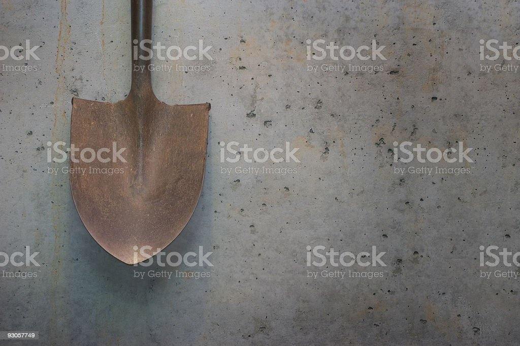 Shovel Against Cement royalty-free stock photo