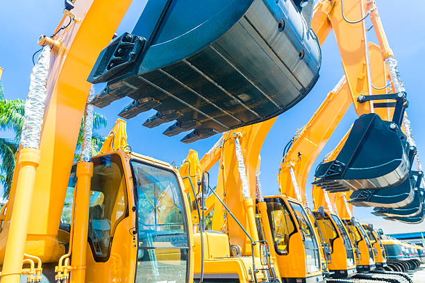 Shovel excavator on Asian machinery  rental company Asian Vehicle fleet with construction machinery of building or mining company construction machinery stock pictures, royalty-free photos & images