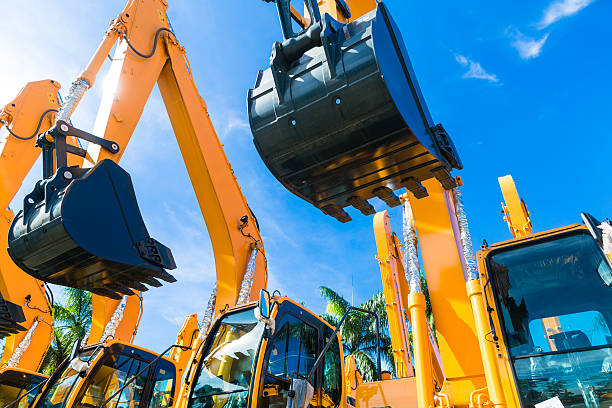 Shovel excavator on Asian  rental company site Vehicle fleet with construction machinery of building or mining company construction machinery stock pictures, royalty-free photos & images