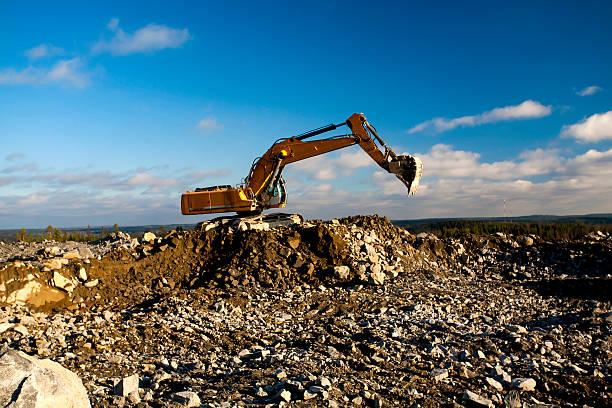 Shovel Excavator on the Pile of Stones stock photo