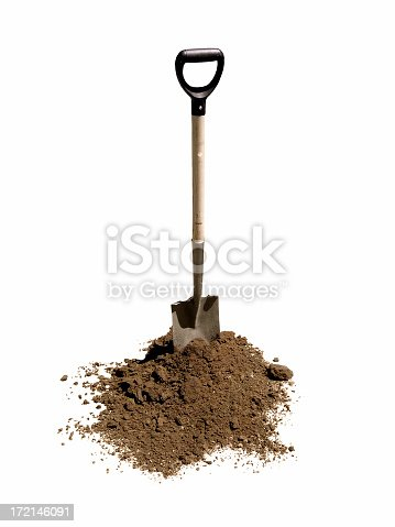 Shovel standing in heap of dirt. On pure white.