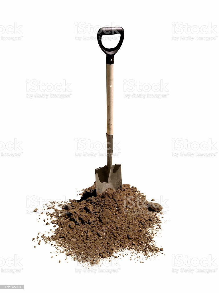 Shovel in heap of dirt stock photo