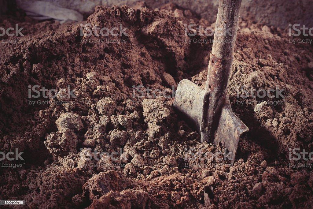 Shovel in sand stock photo