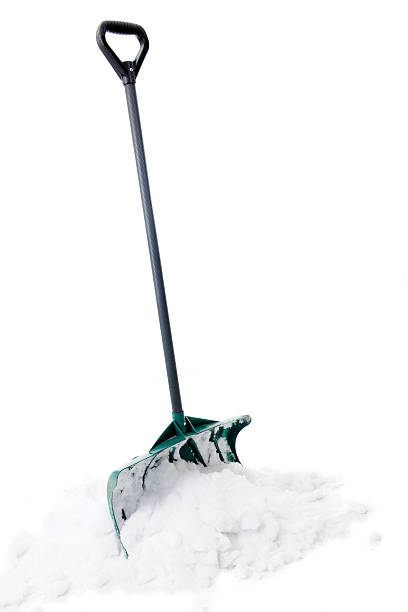 shovel in snow - snow pile stock photos and pictures