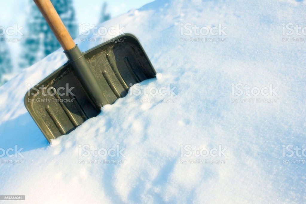 Shovel in the snow stock photo