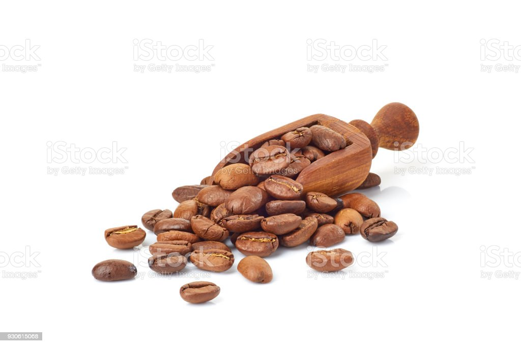 Shovel with roasted coffee beans on white stock photo