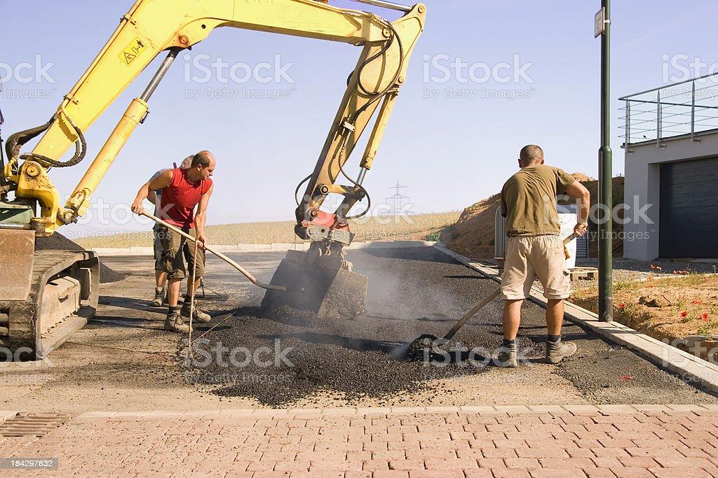 Shoveling Hot Asphalt royalty-free stock photo