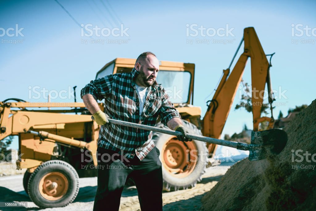 Shoveling Is Dusty And Hard Occupation stock photo