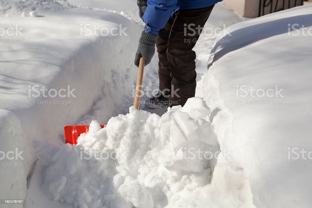 Shoveling Removing Snow at Residential Home After Winter Blizzard Storm stock photo