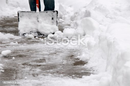 clearing heavy wet snow from the sidewalk after a winter storm.See more related images in my Winter Snow Removal lightbox: