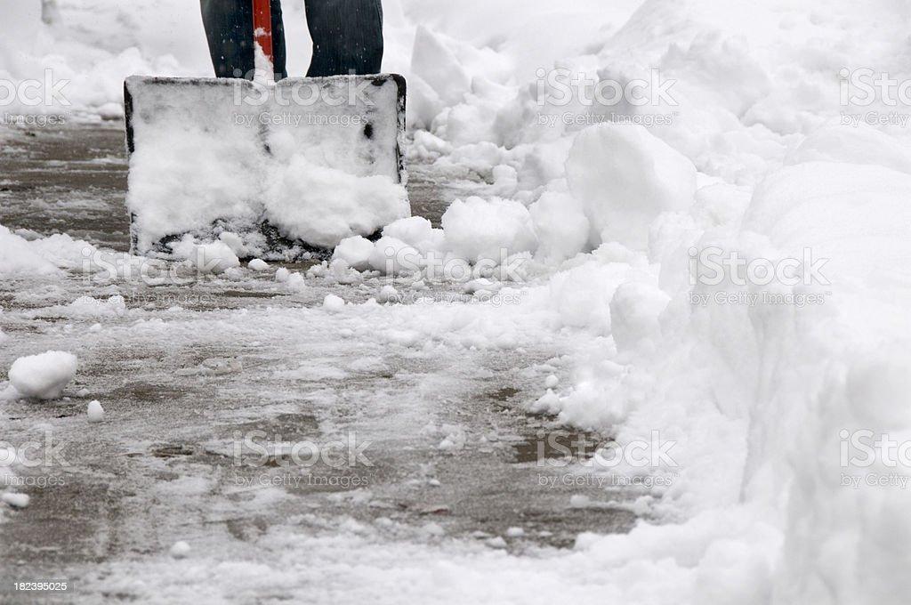 Shoveling Snow from Sidewalk stock photo