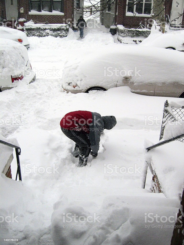 shoveling snow in brooklyn blizzard stock photo