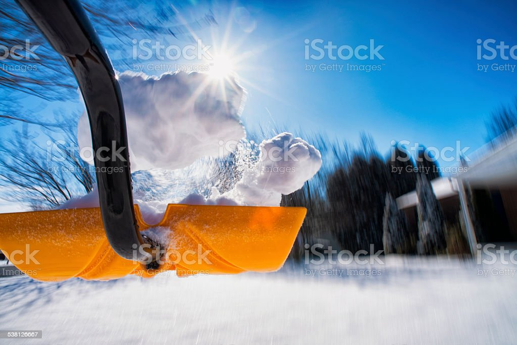 Shoveling snow in motion, throwing snow stock photo