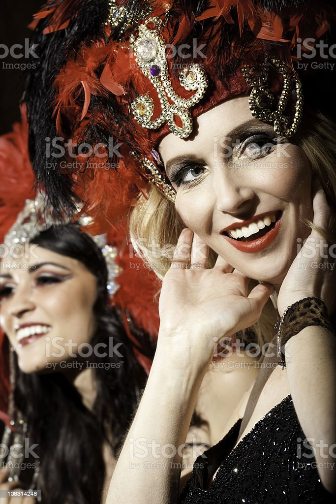 Show Girl with Hands to Her Face Looking at Crowd royalty-free stock photo