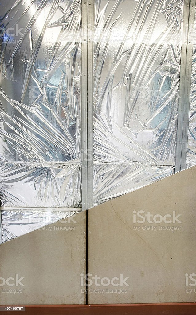 show layers of wall consrtuction insulation froy stock photo