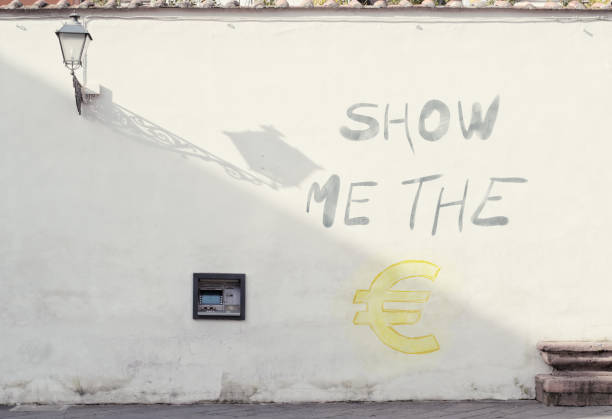 show me the money, graffiti by a bank cash point stock photo