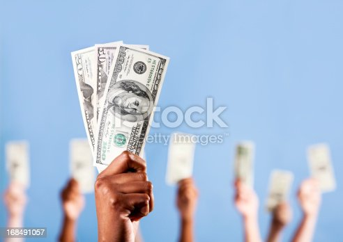 istock Show me the money! Many hands holding up US dollars 168491057