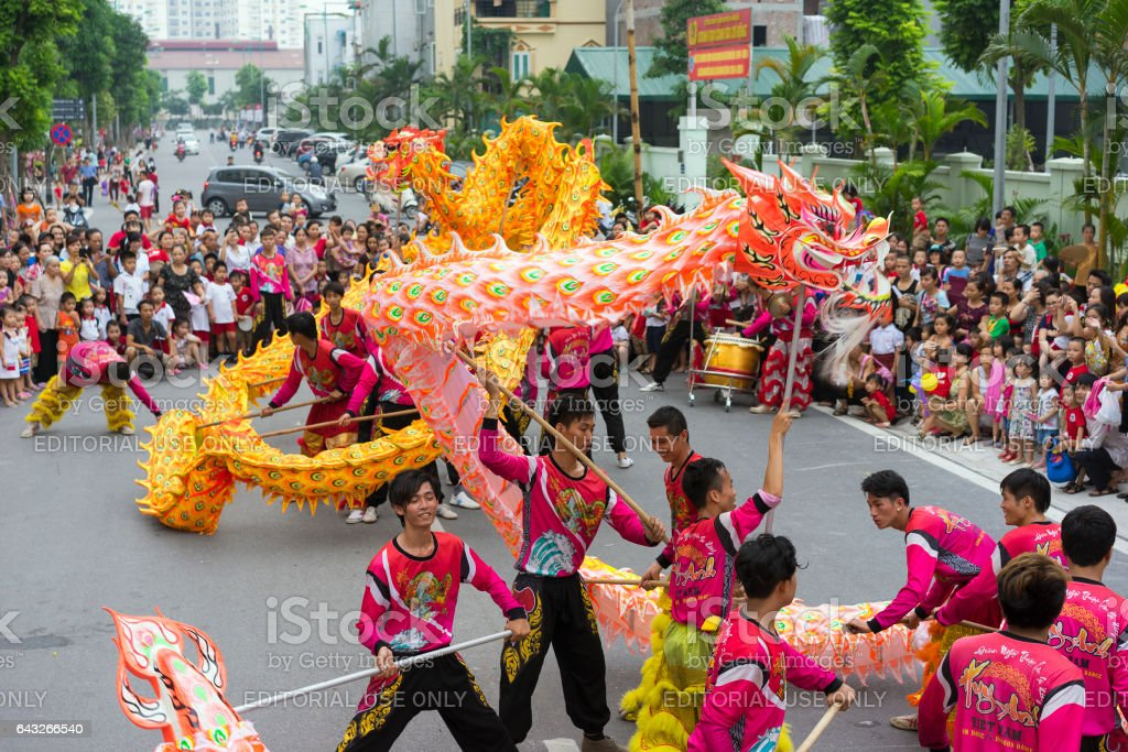 Hanoi, Vietnam - Sept 8, 2014: A show of dragon and lion dance performed at lunar mid autumn festival at Times City Complex. This is a form of traditional dance and performance in Vietnamese culture stock photo