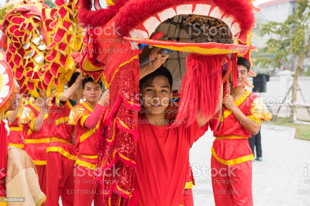 Hanoi, Vietnam - Feb 7, 2015: A show of lion and dragon dance at Vietnamese lunar new year festival organized at Vinschool, Vinhomes Times City, Minh Khai street stock photo