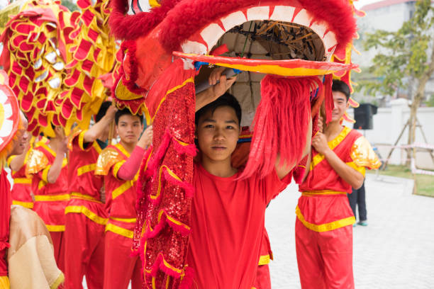 Hanoi, Vietnam - Feb 7, 2015: A show of lion and dragon dance at Vietnamese lunar new year festival organized at Vinschool, Vinhomes Times City, Minh Khai street stock photo