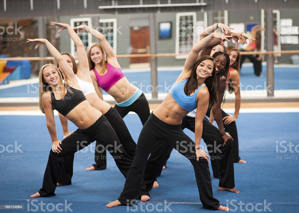 Show of those abs! Beautiful young women working out. royalty-free stock photo
