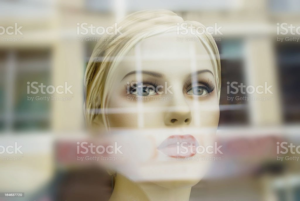 show window mannequin face behind store glass royalty-free stock photo