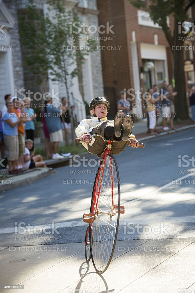Showboating Penny Farthing Bicycle Racer stock photo