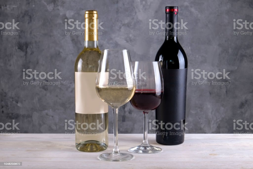 Two bottles of red and white wine with matte black & white blank...