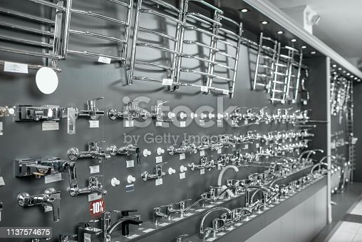Showcase with plumbing taps and sanitary in the shop