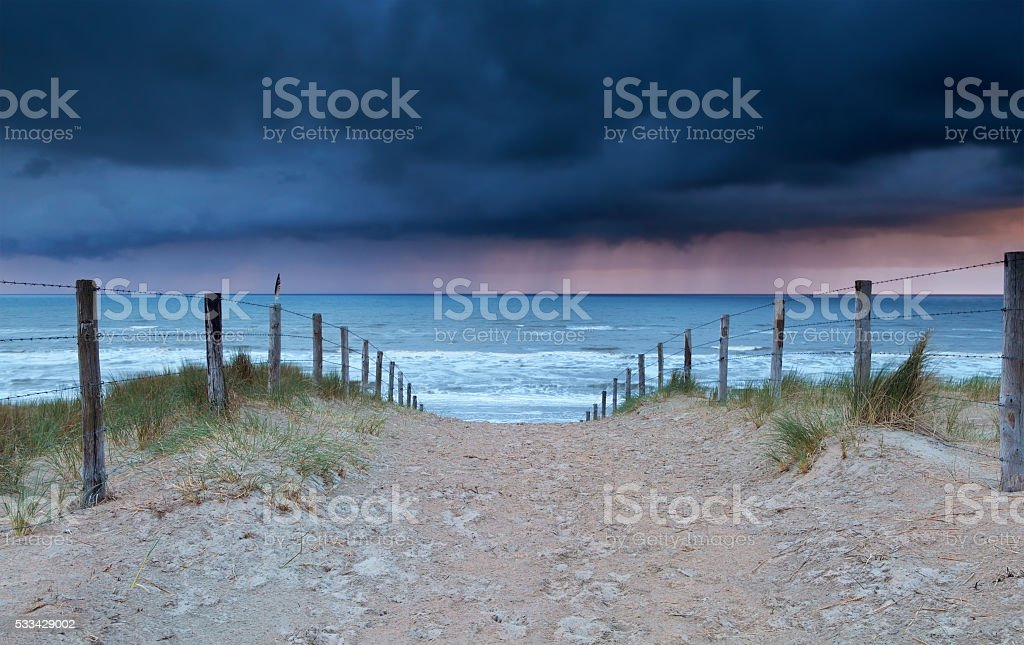 shower coming from north sea to beach stock photo