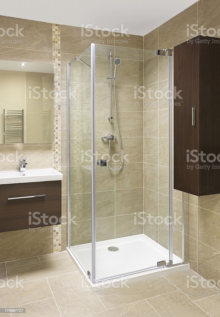 shower cubicle and stone tiles stock photo